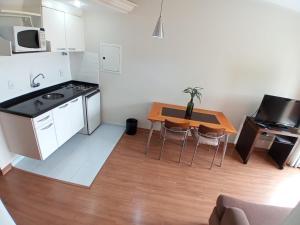 A kitchen or kitchenette at Guará Inn Flat Service