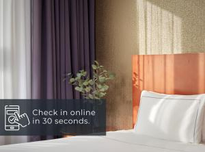 A bed or beds in a room at Park Plaza Nottingham