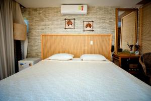 A bed or beds in a room at Safari Natal Beach Hotel