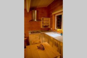 A kitchen or kitchenette at Le Spa du Cabanon: Cabanon de luxe avec Spa entièrement privatif