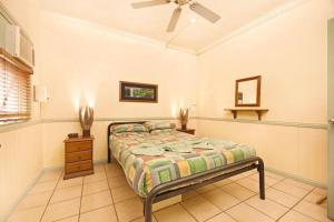A bed or beds in a room at Tropic Days Boutique Hostel