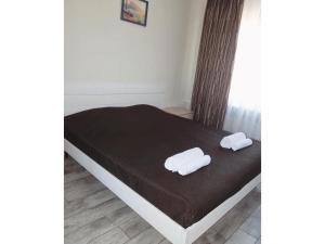 """Кровать или кровати в номере Гостевой дом """"Центральный"""""""