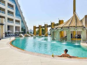 The swimming pool at or near Raffles Dubai