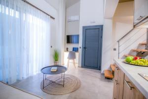 A kitchen or kitchenette at Aelia Seaside Luxury Suites