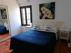 A bed or beds in a room at Casa Fayna Playa Honda