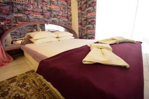 Кровать или кровати в номере Гостевой Дом Семья