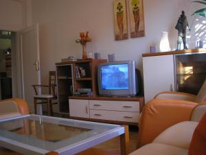 A television and/or entertainment center at Apartment Accommodation up to 17