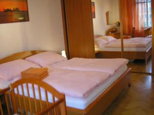 A bed or beds in a room at Apartment Accommodation up to 17