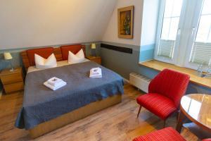 Ein Bett oder Betten in einem Zimmer der Unterkunft Himmelreich Rügen
