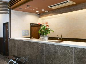 The lobby or reception area at Hotel Wing International Hitachi