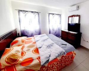 A bed or beds in a room at Higuey City. Free Wifi/ free parking/ 2 bed/ ofice