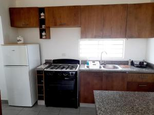 A kitchen or kitchenette at Higuey City. Free Wifi/ free parking/ 2 bed/ ofice