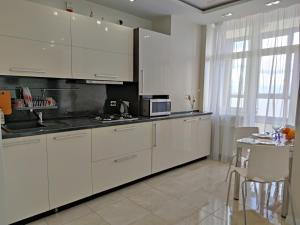Кухня или мини-кухня в Gorkovo 96
