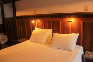Cama ou camas em um quarto em Casa de Hospedagem Paraty