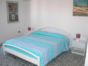 A bed or beds in a room at Al Martin Pescatore