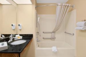 A bathroom at Days Inn by Wyndham Americus
