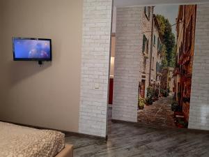 """Телевизор и/или развлекательный центр в Apartment """" South"""""""