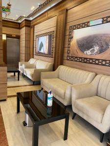 Uma área de estar em Mirage Al Salam Hotel