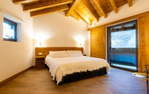 A bed or beds in a room at Hotel Gredos Maria Justina Adults Only