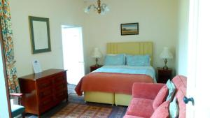 A bed or beds in a room at Manoir La Breuille