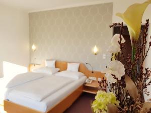 Ein Bett oder Betten in einem Zimmer der Unterkunft Hotel-Restaurant Teuschler-Mogg
