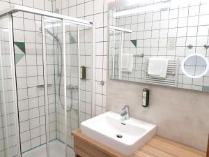 Ein Badezimmer in der Unterkunft Hotel-Restaurant Teuschler-Mogg