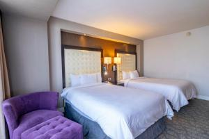 A bed or beds in a room at Hotel Lucerna Tijuana