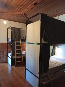 A bunk bed or bunk beds in a room at Albergue Albor