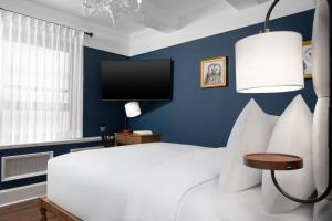 A bed or beds in a room at voco The Franklin New York, an IHG Hotel