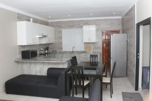 A kitchen or kitchenette at Royal Luxury Hotels and Apartments