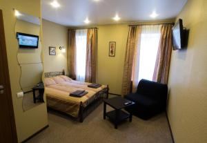 A bed or beds in a room at Coffee s Molokom na Fontanke