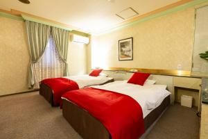 A bed or beds in a room at Hotel Liberty Kochi (Adult Only)