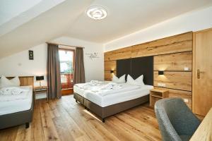 Ein Bett oder Betten in einem Zimmer der Unterkunft Hotel Rupertihof