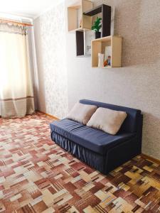 Кровать или кровати в номере Апартаменты на прудах