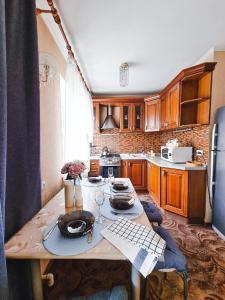 Кухня или мини-кухня в Апартаменты на прудах