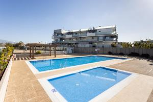 The swimming pool at or near 135 SOTAVENTO BLUE SKY Tejita Beach Experience by SUNKEYRENTS
