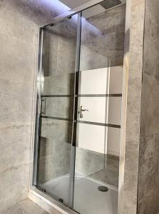 A bathroom at New apartment golden square