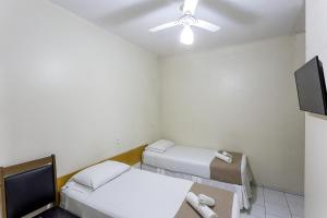 A bed or beds in a room at Hotel Marjaí
