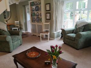 A seating area at The Saddlery Holiday Cottage