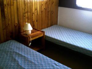 Un ou plusieurs lits dans un hébergement de l'établissement Domaine de Monadière