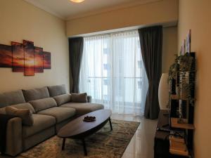 A seating area at Comfortable Partial Palm View 1 BR Dubai Marina