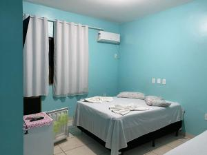 A bed or beds in a room at Temporada Ilhéus - Praia dos Milionários - Pousada Palomar