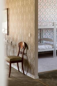 Säng eller sängar i ett rum på Immeln Guest House