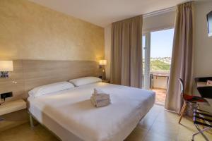Cama o camas de una habitación en Hotel Sa Barrera - Adults Only