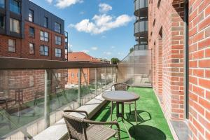 A balcony or terrace at Browar Gdanski Budget by Renters