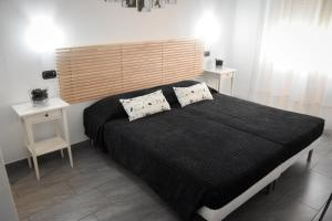 A bed or beds in a room at Affittacamere Delfo