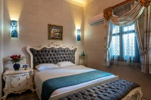 A bed or beds in a room at The Dream Compound- by Biankini