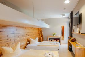 A bed or beds in a room at Hostel Haus 54