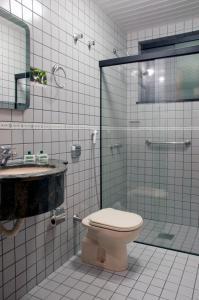 Um banheiro em Grande Hotel Guarapuava