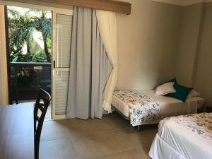 Cama ou camas em um quarto em Hotel Costa Norte Massaguaçu